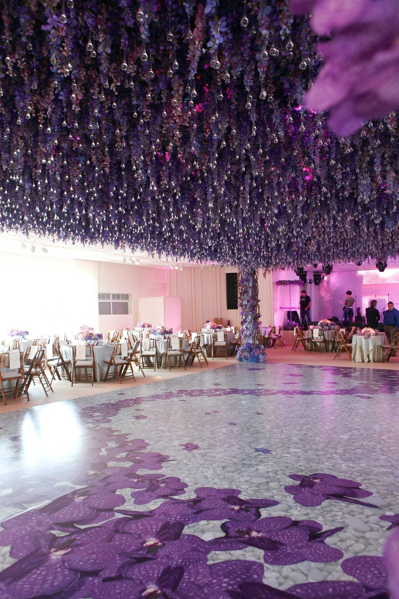 Reception dcor photos hanging purple flowers over dance floor a structure made of pink and purple flowers purple flowers hanging crystals over floral dance floor mightylinksfo