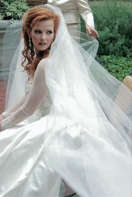 Bride in classic dress with long cathedral veil