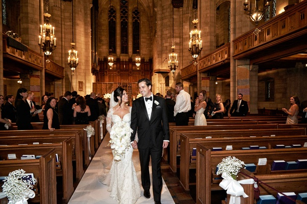 Bride in Galia Lahav wedding dress walking up aisle with groom tuxedo gothic revival church ceremony