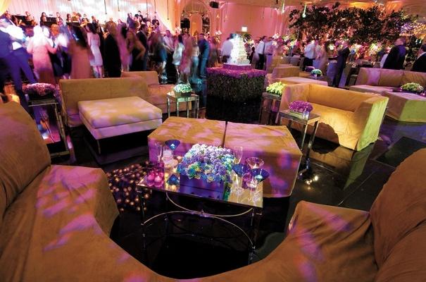 Nightclub inspired reception lounge area next to dance floor