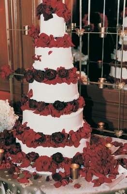Classic white wedding cake with red floral tiers