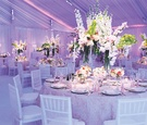 Indoor reception with drapery and pink and purple lighting