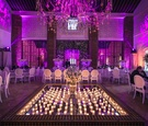 purple pink lighting mirror center candles destination wedding morocco opulent modern traditional