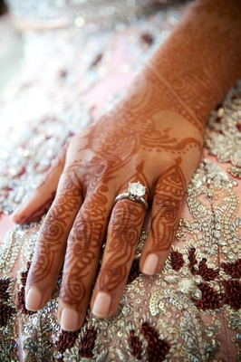 Indian bride's henna hands and solitare ring