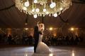 bride in berta mermaid wedding dress with groom in tuxedo on dance floor