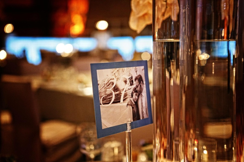 Wedding table numbers printed on sepia-tone photos of the couple