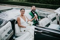 wedding car getaway ceremony to reception transportation groom in green tuxedo jacket champagne