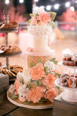 Three layer cake with sugar flowers and lace