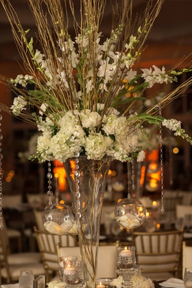 towering vase with gold branches, white stock, hydrangeas, orchids, crystal strands, globes