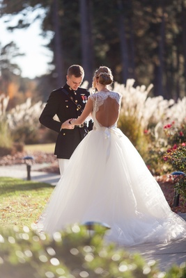 Bride at first look wearing keyhole back Monique Lhuillier dress
