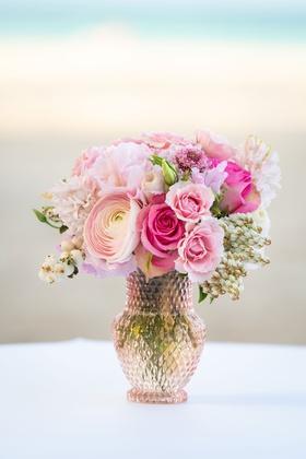 wedding reception centerpiece pink rose ranunculus flowers in light pink crystal vase beach ocean