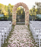 rooftop wedding ceremony, petal-lined aisle, arch of ivory and pink roses