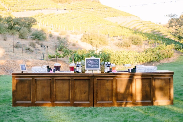 outdoor wooden bar vineyard rustic chic wedding professional event california cocktails lawn farm