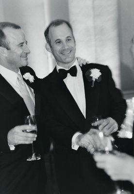 Black and white photo of groom with his best man