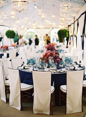 French blue table linens topped with hydrangeas