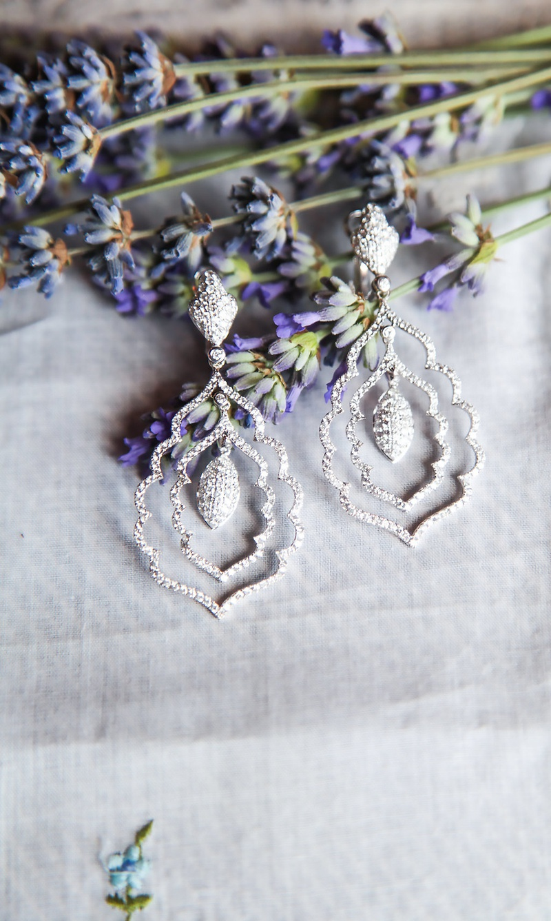 silver sparkling chandelier earrings with layers around center