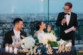 father of the bride gives toast standing by sweetheart table