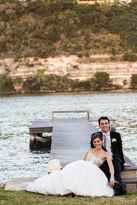 Young couple on dock of lake in Austin, Texas