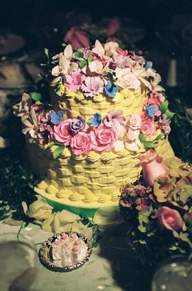 Yellow basket wedding cake with sugar flowers on top