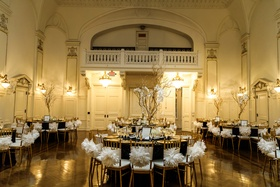 gold, black, and ivory color palete at wedding reception