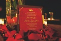 Red wedding invitation with gold lettering and butterfly motif