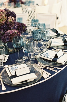 White-and-navy table linens with blue goblets