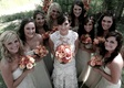 Bride in a lace Monique Lhuillier gown and bridesmaids in strapless dresses