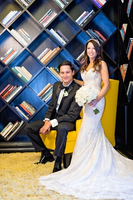 viceory santa monica wedding, bride in eddy k, groom in calvin klein, geometric bookshelf