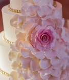 Cake adorned with cascading pink sugar flower