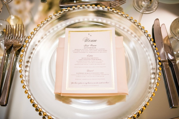 Gold foil border wedding menu card on gold beaded charger plate blush napkin calligraphy