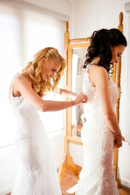 sisters, two brides, mermaid wedding gowns, bride getting ready double wedding