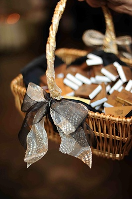 Gold matchboxes in ribbon-embellished basket