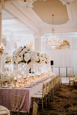 reception ballroom pink linen tall centerpiece pink rose white hydrangea gold chair candles
