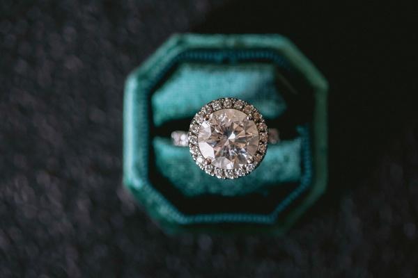 wedding ring engagement ring in velvet teal ring box large round diamond halo setting