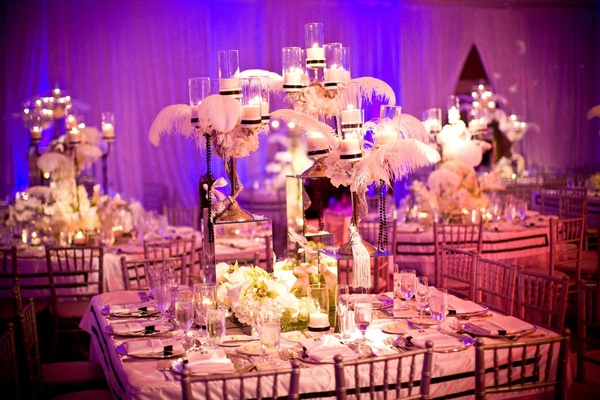 Mirror centerpiece with candles, feathers, and flowers