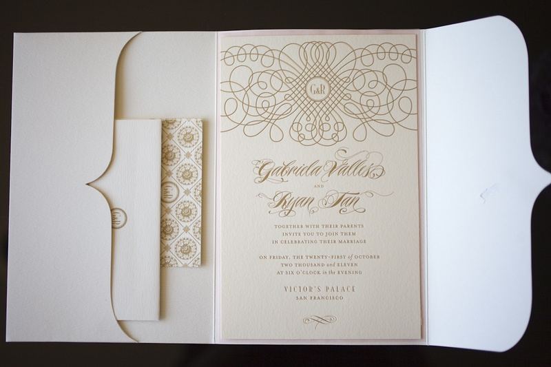 Ivory envelope with gold lettering and design