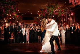 bride in vera wang wedding dress groom in white jacket first dance beautiful photo dip guests watch