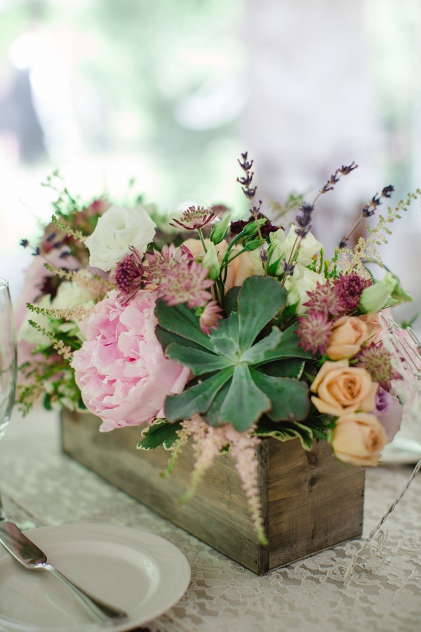 rustic centerpiece with pink peonies, succulents, peach roses in wooden planter