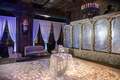 Wedding reception styled shoot lounge area cake table foliage motif on dance floor flower wall