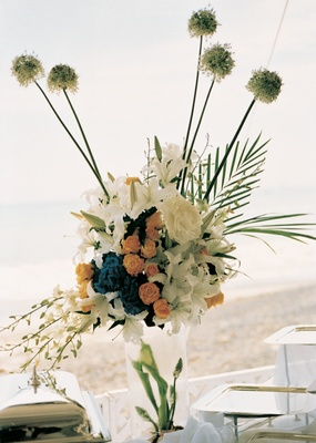 Floral arrangement on top of ice vase and buffet table