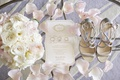 white gold foil wedding invitation suite with wedding rings silver jimmy choo heels white pink flora