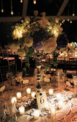 Candelabra centerpieces with large flowers