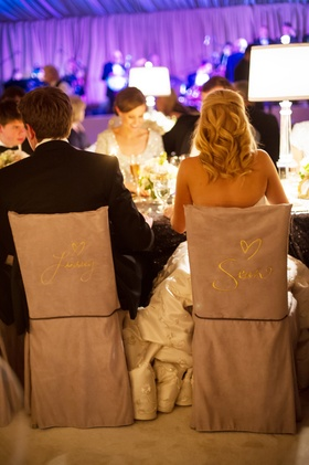 Bride and groom chairs with embroidered names
