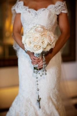 Courtney Mazza holding roses and rosary