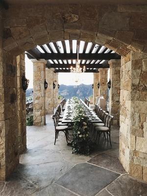 malibu rocky oaks wedding venue, long reception table, floral runner with heavy greenery, chandelier