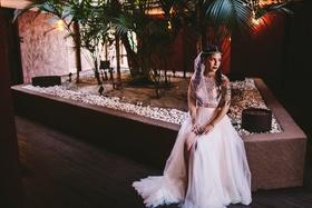 tattooed bride in crop top wedding dress from bhldn slit in skirt, pearl headpiece
