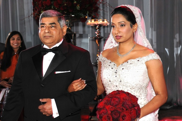 Indian dad escorting bride down the aisle