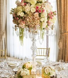 Candelabra with gold accents and flowers