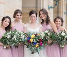 bride white bridesmaids pastel pink light dresses wedding dayton ohio colorful bouquet style