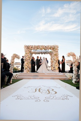 Monogram aisle runner and floral chuppah